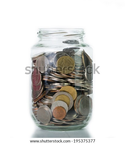 Saving money into bottle for cash in future investment - stock photo