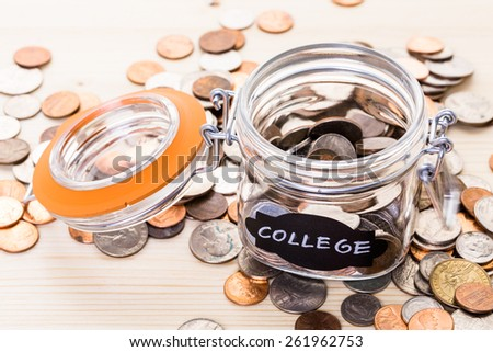Saving money into glass jar for future investment. - stock photo