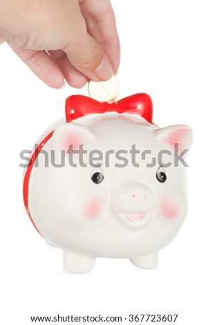 Saving money, male hand is putting coin into piggy bank isolated on white - stock photo