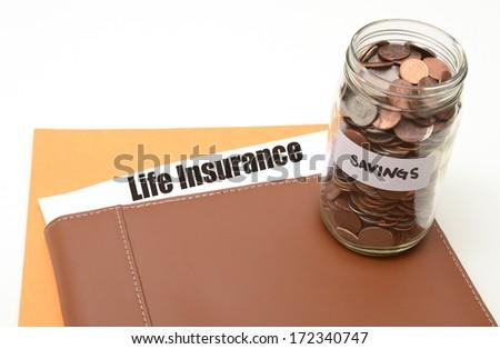 saving money on life insurance concept - stock photo