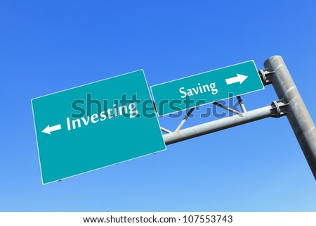 Saving or investing money in road traffic sign with blue sky, concept for business - stock photo
