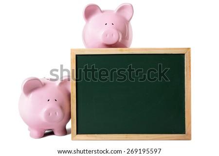 Saving plan concept, piggy bank, blackboard, copy space - stock photo