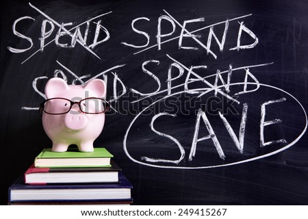 Saving plan : piggy bank with glasses by blackboard with spend, save advice.   - stock photo