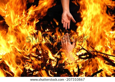 Saving Someone from the Fire - stock photo