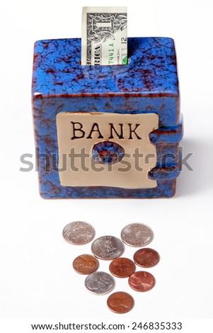 Savings bank with money - stock photo