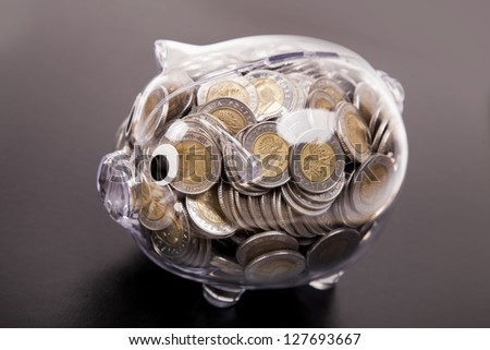 Savings in piggy bank! A lot of money! Isolated on white background! - stock photo