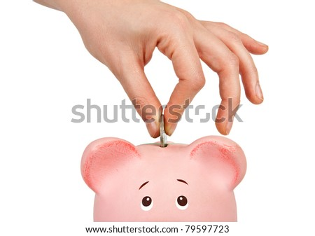 Savings - Piggy bank and hand with coin - stock photo