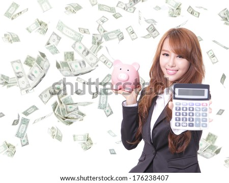 Savings woman smiling holding pink piggy bank and calculator with money rain background. Asian - stock photo