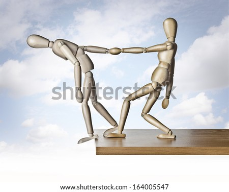 Savior. Two manikins, anatomical model, placed on the edge of a board  - stock photo