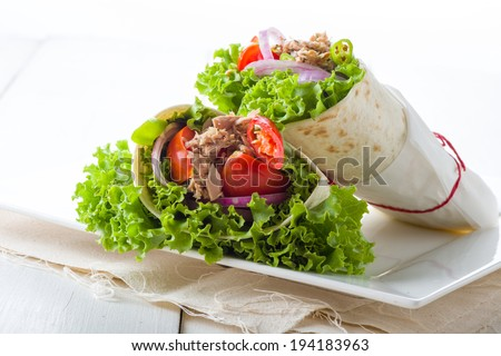 Savory chicken tortilla with abundant serving of vegetables - stock photo
