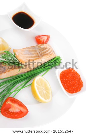 savory fish portion : norwegian salmon fillet pieces roasted with chinese onion, lemon, rosemary twig and red caviar on white dish isolated over white background - stock photo