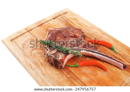 savory : grilled spare rib on wooden plate with thyme isolated over white background - stock photo