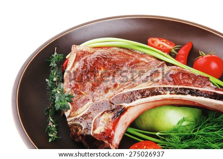 savory : roasted beef spare rib on dark dish with cutlery thyme pepper and tomato isolated over white background - stock photo