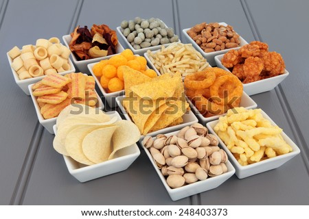 Savory snack party food selection in square porcelain bowls. - stock photo