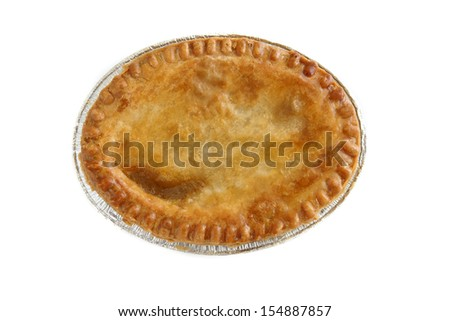 Savoury meat pie in a foil tray top down view studio isolated - stock photo