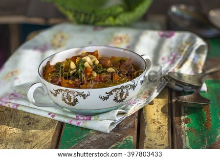 Savoy cabbage stew with carrot and borlotti beans - stock photo