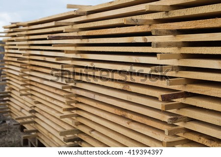 sawmill, wood processing, timber drying,  timber harvesting, drying boards, baulk. harvesting at the sawmill, the construction of a wooden house, the wood is dried, hydrothermal treatment of wood  - stock photo