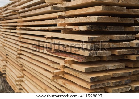 sawmill, wood processing, timber drying, timber harvesting, drying boards, baulk, lumber-mill, wood forest products industry, enterprises for the primary processing of wood,  work at the sawmill     - stock photo