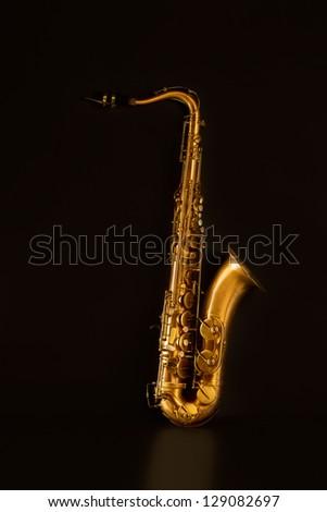 Sax golden tenor saxophone in black background - stock photo