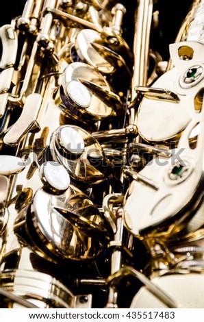 Saxophone alto jazz music instrument close up isolated on black   - stock photo