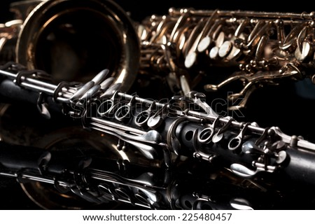 saxophone and clarinet in black background - stock photo