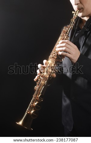 Saxophone classical music instrument Saxophonist with soprano sax - stock photo
