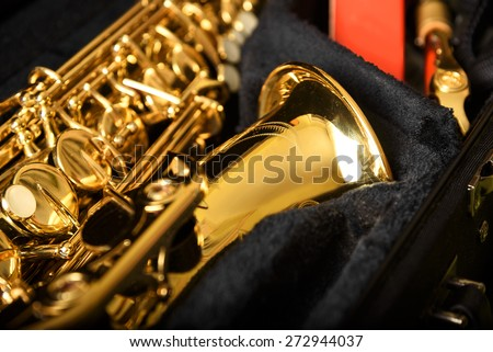 Saxophone detail against the background of a velvet cover - stock photo