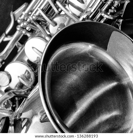 Saxophone instrument in black and white with pointillism film grain effect - stock photo