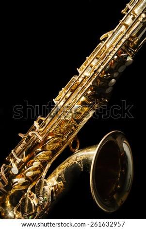 Saxophone isolated on black background - stock photo