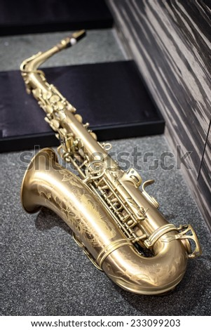 Saxophone on marble table - stock photo