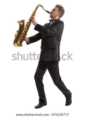 Saxophonist. Middle aged man playing on saxophone isolated on background - stock photo