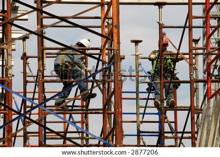 scaffold and workers - stock photo