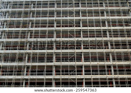 Scaffolding as architectural background - stock photo