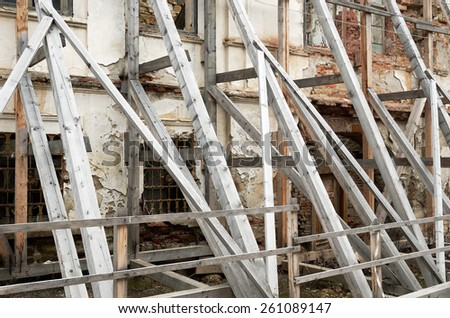 Scaffolding Covering an old building under restoration - stock photo
