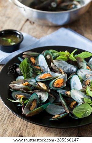 scald mussel with thai sweet basil and spicy seafood sauce - stock photo