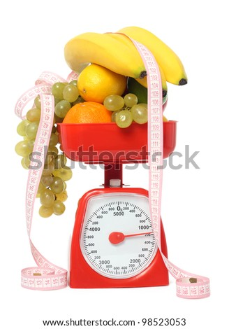 Scale with fruits isolated - stock photo