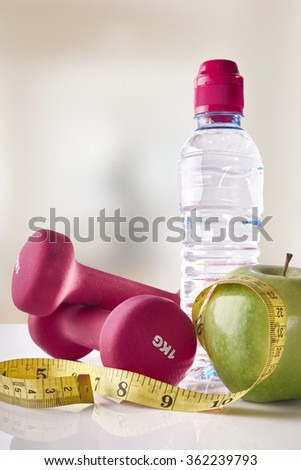 Scale with healthy heart message and measuring tape on white table. Weight control concept. Horizontal composition. Top view - stock photo