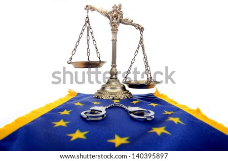 Scales of Justice,European Union flag and handcuffs. European Union Law concept. - stock photo