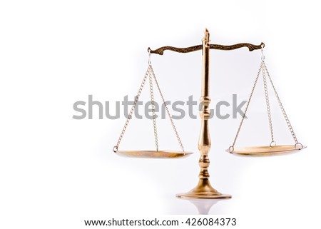 Scales of justice - the symbol of law - isolated, white background - stock photo