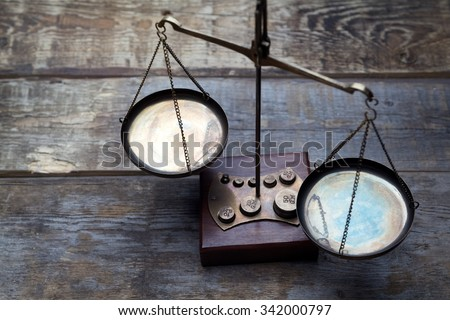 Scales on wooden background - stock photo