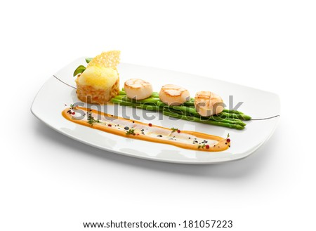 Scallop with Asparagus and Risotto - stock photo