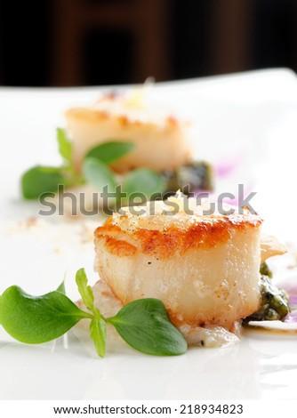 Scallops shells with thai basil pesto - stock photo