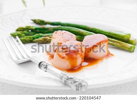Scallops with asparagus - stock photo