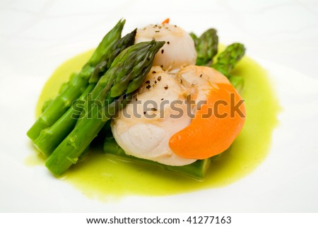 scallops with asparagus and sauce - stock photo