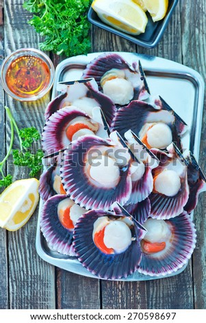 scallops with oil and salt on the tray - stock photo