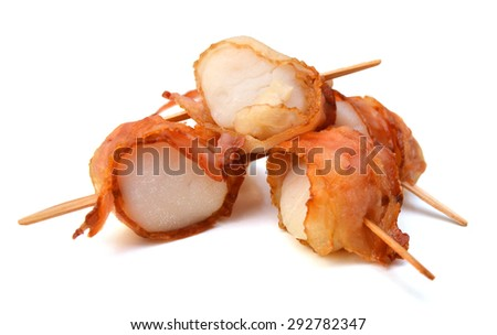 Scallops wrapped in bacon and seared, close-up on white background  - stock photo
