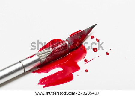 Scalpel knife cutting with blood - stock photo