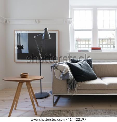 Scandi styled living room interior in art deco Australian apartment - stock photo