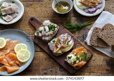 Scandinavian open sandwiches with mackerel, salmon and herrings - stock photo