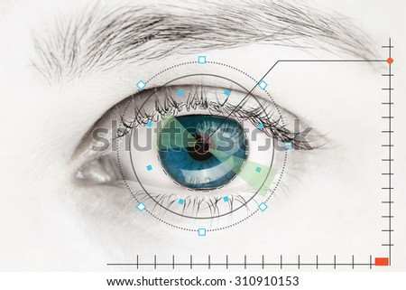 Scanner on blue human eye - stock photo